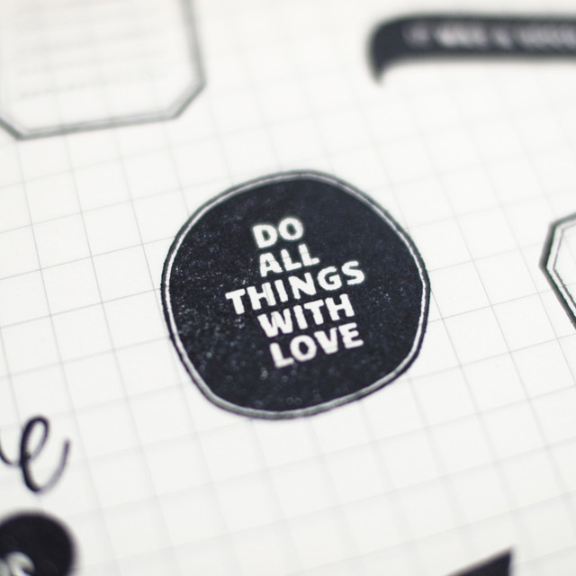 Stamp 'do all things with love'