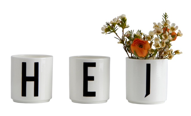 Cups with Arne Jacobsen typography by Design Letters